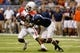 Sep 28, 2013; San Antonio, TX, USA; Houston Cougars wide receiver Daniel Spencer (4) is tackled by Texas-San Antonio Roadrunners safety Triston Wade (7) during the second  half at Alamodome. Houston won 59 - 28. Mandatory Credit: Soobum Im-USA TODAY Sports