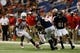 Sep 28, 2013; San Antonio, TX, USA; Texas-San Antonio Roadrunners running back Evans Okotcha(front) is tackled by Houston Cougars defensive back Turon Walker (behind) during the second  half at Alamodome. Houston won 59 - 28. Mandatory Credit: Soobum Im-USA TODAY Sports