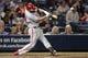 Sep 28, 2013; Atlanta, GA, USA; Philadelphia Phillies first baseman Kevin Frandsen (28) hits a single against the Atlanta Braves in the eighth inning at Turner Field. The Phillies defeated the Braves 5-4. Mandatory Credit: Brett Davis-USA TODAY Sports