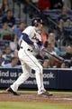 Sep 28, 2013; Atlanta, GA, USA; Atlanta Braves first baseman Freddie Freeman (5) hits a single against the Philadelphia Phillies in the eighth inning at Turner Field. Mandatory Credit: Brett Davis-USA TODAY Sports