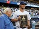 Sep 28, 2013; Los Angeles, CA, USA;   Los Angeles Dodgers Tommy Lasorda presents the Roy Campanella award to pitcher Clayton Kershaw (22) before the game against the Colorado Rockies at Dodger Stadium. Mandatory Credit: Jayne Kamin-Oncea-USA TODAY Sports