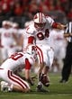 Sep 28, 2013; Columbus, OH, USA; Wisconsin Badgers kicker Kyle French (94) kicks an extra point during the fourth quarter against the Ohio State Buckeyes at Ohio Stadium. Buckeyes beat the Badgers 31-24. Mandatory Credit: Raj Mehta-USA TODAY Sports