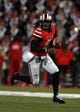 Sep 28, 2013; Columbus, OH, USA; Ohio State Buckeyes quarterback Braxton Miller (5) runs the ball during the fourth quarter against the Wisconsin Badgers at Ohio Stadium. Buckeyes beat the Badgers 31-24. Mandatory Credit: Raj Mehta-USA TODAY Sports