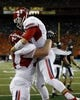 Sep 28, 2013; Honolulu, HI, USA; Fresno State quarterback Derek Carr (4) celebrates with teammate offensive linesman Justin Northern (54) after Carr made a touchdown against Hawaii during the second quarter of the NCAA college football game at Aloha Stadium. Mandatory Credit: Marco Garcia-USA TODAY Sports