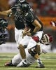 Sep 28, 2013; Honolulu, HI, USA; Hawaii quarterback Ikaika Woolsey (15) is brought down by Fresno State linebacker Patrick Su'a (30) during the second quarter at Aloha Stadium. Mandatory Credit: Marco Garcia-USA TODAY Sports
