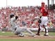 Sep 29, 2013; Cincinnati, OH, USA; Pittsburgh Pirates shortstop Jordy Mercer (10) slides into home safe to score on an inside the park home run during the second inning against the Cincinnati Reds at Great American Ball Park. Mandatory Credit: Frank Victores-USA TODAY Sports