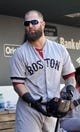 Sep 29, 2013; Baltimore, MD, USA; Boston Red Sox first baseman Mike Napoli (12) in the dugout during a game against the Baltimore Orioles at Oriole Park at Camden Yards. Mandatory Credit: Joy R. Absalon-USA TODAY Sports
