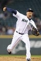 Sep 29, 2013; Seattle, WA, USA; Seattle Mariners relief pitcher Hector Noesi (45) pitches to the Oakland Athletics during the second inning at Safeco Field. Mandatory Credit: Steven Bisig-USA TODAY Sports