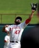 Sep 29, 2013; Arlington, TX, USA; Los Angeles Angels second baseman Howie Kendrick (47) makes a jumping catch in the fourth inning of the game against the Texas Rangers at Rangers Ballpark in Arlington. Mandatory Credit: Tim Heitman-USA TODAY Sports