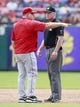 Sep 29, 2013; Arlington, TX, USA; Los Angeles Angels manager Mike Scioscia (14) talks with first base umpire Ted Barrett (65) during the game against the Texas Rangers at Rangers Ballpark in Arlington. Mandatory Credit: Tim Heitman-USA TODAY Sports