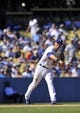 September 29, 2013; Los Angeles, CA, USA; Los Angeles Dodgers shortstop Michael Young (10) throws to first to complete an out in the fifth inning against the Colorado Rockies at Dodger Stadium. Mandatory Credit: Gary A. Vasquez-USA TODAY Sports