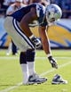 Sep 29, 2013; San Diego, CA, USA; Dallas Cowboys tackle Tyron Smith (77) loses a shoe during a fourth quarter play against the San Diego Chargers at Qualcomm Stadium.  Mandatory Credit: Robert Hanashiro-USA TODAY Sports