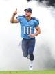 Sep 29, 2013; Nashville, TN, USA; Tennessee Titans quarterback Jake Locker (10) is introduced before a game against the New York Jets at LP Field. The Titans beat the Jets 38-13. Mandatory Credit: Don McPeak-USA TODAY Sports