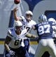 Sep 29, 2013; San Diego, CA, USA; San Diego Chargers quarterback Philip Rivers (17) throws a pass over Chargers center Nick Hardwick (61) during first half action against the Dallas Cowboys at Qualcomm Stadium.  Mandatory Credit: Robert Hanashiro-USA TODAY Sports