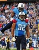 Sep 29, 2013; Nashville, TN, USA; Tennessee Titans linebacker Zach Brown (55) celebrates with defensive end Ropati Pitoitua (92) after a defensive play against the New York Jets during the second half at LP Field. The Titans beat the Jets 38-13. Mandatory Credit: Don McPeak-USA TODAY Sports