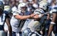 Sep 29, 2013; San Diego, CA, USA; San Diego Chargers quarterback Philip Rivers (17) points as he calls a play at the line of scrimmage during the first half against the Dallas Cowboys at Qualcomm Stadium.  Mandatory Credit: Robert Hanashiro-USA TODAY Sports