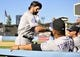 September 29, 2013; Los Angeles, CA, USA; Colorado Rockies first baseman Todd Helton (17) is greeted by manager Walt Weiss (22) following his final at bat of the game in the ninth inning against the Los Angeles Dodgers at Dodger Stadium. Mandatory Credit: Gary A. Vasquez-USA TODAY Sports
