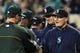 Sep 29, 2013; Seattle, WA, USA; Oakland Athletics manager Bob Melvin (6) and Seattle Mariners manager Eric Wedge (22) shake hands after the game between the Seattle Mariners and the Oakland Athletics at Safeco Field. Oakland defeated Seattle 9-0. Mandatory Credit: Steven Bisig-USA TODAY Sports