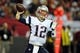 Sep 29, 2013; Atlanta, GA, USA; New England Patriots quarterback Tom Brady (12) passes against the Atlanta Falcons during the second half at Georgia Dome. The Patriots defeated the Falcons 30-23. Mandatory Credit: Dale Zanine-USA TODAY Sports