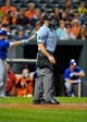Sep 25, 2013; Baltimore, MD, USA; Home plate umpire Chris Guccione during a game between the Toronto Blue Jays and the Baltimore Orioles at Oriole Park at Camden Yards. The Orioles defeated the Blue Jays 9-5. Mandatory Credit: Joy R. Absalon-USA TODAY Sports