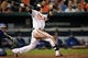 Sep 25, 2013; Baltimore, MD, USA; Baltimore Orioles left fielder Nate McLouth (9) bats in the eighth inning against the Toronto Blue Jays at Oriole Park at Camden Yards. The Orioles defeated the Blue Jays 9-5. Mandatory Credit: Joy R. Absalon-USA TODAY Sports