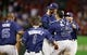 Sep 30, 2013; Arlington, TX, USA; Tampa Bay Rays starting pitcher David Price (middle) is mobbed by his teammates after pitching a complete game to defeat the Texas Rangers 5-2 at Rangers Ballpark at Arlington. Mandatory Credit: Tim Heitman-USA TODAY Sports