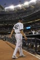 Sep 26, 2013; Bronx, NY, USA; New York Yankees relief pitcher Mariano Rivera (42) walks off the field after being honored before his final home game against the Tampa Bay Rays at Yankee Stadium. Mandatory Credit: Brad Penner-USA TODAY Sports