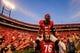 Sep 28, 2013; Athens, GA, USA; Georgia Bulldogs cornerback Damian Swann (5) and offensive tackle Zach DeBell (76) celebrate beating the LSU Tigers at Sanford Stadium. Georgia won 44-41. Mandatory Credit: Daniel Shirey-USA TODAY Sports