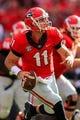 Sep 28, 2013; Athens, GA, USA; Georgia Bulldogs quarterback Aaron Murray (11) scrambles on a pass play in the first half against the LSU Tigers at Sanford Stadium. Georgia won 44-41. Mandatory Credit: Daniel Shirey-USA TODAY Sports