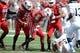 Sep 21, 2013; Louisville, KY, USA; Louisville Cardinals linebacker James Burgess (13) reacts after tackling FIU Golden Panthers running back Lamarq Caldwell (36) during the first quarter of play at Papa John's Cardinal Stadium. Louisville defeated FIU 72-0.  Mandatory Credit: Jamie Rhodes-USA TODAY Sports