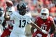 Sep 21, 2013; Louisville, KY, USA; FIU Golden Panthers quarterback E.J. Hilliard (13) looks to pass against the Louisville Cardinals during the second half of play at Papa John's Cardinal Stadium. Louisville defeated FIU 72-0.  Mandatory Credit: Jamie Rhodes-USA TODAY Sports