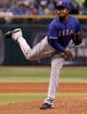 Sep 16, 2013; St. Petersburg, FL, USA; Texas Rangers pitcher Neftali Feliz (30) throws a pitch against the Tampa Bay Rays at Tropicana Field. Tampa Bay Rays defeated the Texas Rangers 6-2. Mandatory Credit: Kim Klement-USA TODAY Sports