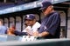 Sep 18, 2013; St. Petersburg, FL, USA; Tampa Bay Rays manager Joe Maddon (70) and bench coach Dave Martinez (4) watch from the dugout against the Texas Rangers at Tropicana Field. Mandatory Credit: Kim Klement-USA TODAY Sports