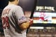 Oct 1, 2013; Pittsburgh, PA, USA; A detailed view of the postseason decal on the sleeve of Cincinnati Reds left fielder Chris Heisey (28) in the fifth inning of the National League wild card playoff baseball game at PNC Park. Mandatory Credit: Charles LeClaire-USA TODAY Sports