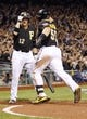 Oct 1, 2013; Pittsburgh, PA, USA; Pittsburgh Pirates catcher Russell Martin (55) is congratulated by shortstop Clint Barmes (12) after hitting a solo home run against the Cincinnati Reds in the seventh inning of the National League wild card playoff baseball game at PNC Park. The Pirates won 6-2. Mandatory Credit: Charles LeClaire-USA TODAY Sports