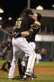 Oct 1, 2013; Pittsburgh, PA, USA; Pittsburgh Pirates relief pitcher Jason Grilli (left) celebrates with catcher Russell Martin (right) after defeating the Cincinnati Reds in the National League wild card playoff baseball game at PNC Park. The Pirates won 6-2. Mandatory Credit: Charles LeClaire-USA TODAY Sports