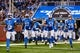 Sep 29, 2013; Detroit, MI, USA; Detroit Lions wide receiver Micheal Spurlock (15) tight end Brandon Pettigrew (87) center Dominic Raiola (51) and free safety John Wendling (29) lead the offense out of the tunnel before the game against the Chicago Bears at Ford Field. Mandatory Credit: Rick Osentoski-USA TODAY Sports
