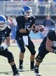 Sep 28, 2013; Buffalo, NY, USA; Buffalo Bulls quarterback Joe Licata (16) takes a snap against the Connecticut Huskies at University of Buffalo Stadium. Buffalo beat Connecticut 41-12. Mandatory Credit: Kevin Hoffman-USA TODAY Sports