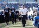 Sep 28, 2013; Buffalo, NY, USA; Buffalo Bulls head coach Jeff Quinn runs with the team to the field to start the game against the Connecticut Huskies at University of Buffalo Stadium. Buffalo beat Connecticut 41-12. Mandatory Credit: Kevin Hoffman-USA TODAY Sports