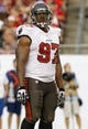 Sep 15, 2013; Tampa, FL, USA; Tampa Bay Buccaneers defensive tackle Akeem Spence (97) during the first half against the New Orleans Saints at Raymond James Stadium. Mandatory Credit: Kim Klement-USA TODAY Sports