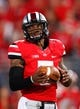 Sep 28, 2013; Columbus, OH, USA; Ohio State Buckeyes quarterback Braxton Miller (5) warms up before the game against the Wisconsin Badgers at Ohio Stadium. Buckeyes beat the Badgers 31-24. Mandatory Credit: Raj Mehta-USA TODAY Sports