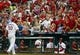 Oct 3, 2013; St. Louis, MO, USA; St. Louis Cardinals starting pitcher Adam Wainwright (50) walks the field off as fans cheer during the seventh inning against the Pittsburgh Pirates in game one of the National League divisional series playoff baseball game at Busch Stadium. St. Louis defeated Pittsburgh 9-1. Mandatory Credit: Jeff Curry-USA TODAY Sports