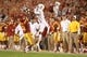 Oct 3, 2013; Ames, IA, USA; Texas Longhorns receiver Shiro Davis (1) goes up for a pass over Iowa State Cyclones corner Jansen Watson (2) at Jack Trice Stadium. Texas beat Iowa State 31-30.   Mandatory Credit: Reese Strickland-USA TODAY Sports