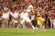 Oct 3, 2013; Ames, IA, USA; Texas Longhorns linebacker Tevin Jackson (11) tackles Iowa State Cyclones running back Aaron Wimberly (2) during the fourth quarter at Jack Trice Stadium. Texas beat Iowa State 31-30.   Mandatory Credit: Reese Strickland-USA TODAY Sports