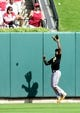 Oct 4, 2013; St. Louis, MO, USA; Pittsburgh Pirates center fielder Andrew McCutchen catches a fly ball in the seventh inning in game two of the National League divisional series playoff baseball game against the St. Louis Cardinals at Busch Stadium. Mandatory Credit: Jeff Curry-USA TODAY Sports