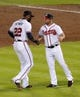 Oct 4, 2013; Atlanta, GA, USA; Atlanta Braves center fielder Jason Heyward (22) high fives second baseman Dan Uggla (right) after defeating the Los Angeles Dodgers in game two of the National League divisional series playoff baseball game at Turner Field. The Braves won 4-3. Mandatory Credit: Dale Zanine-USA TODAY Sports