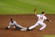 Oct 4, 2013; Atlanta, GA, USA; Atlanta Braves shortstop Andrelton Simmons (19) tags out Los Angeles Dodgers shortstop Dee Gordon (9) on a stolen base attempt in the ninth inning of game two of the National League divisional series playoff baseball game at Turner Field. The Braves won 4-3. Mandatory Credit: Dale Zanine-USA TODAY Sports