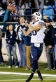 Oct 4, 2013; Logan, UT, USA; Brigham Young Cougars wide receiver Mitch Mathews (10) catches a pass and runs into the end zone for a touchdown against the Utah State Aggies during the third quarter at Romney Stadium. BYU won 31-14. Mandatory Credit: Chris Nicoll-USA TODAY Sports
