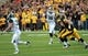 Oct 5, 2013; Iowa City, IA, USA;  Michigan State Spartans quarterback Connor Cook throws a pass to fullback Riley Bullough (30) against the Iowa Hawkeyes at Kinnick Stadium. Mandatory Credit: Reese Strickland-USA TODAY Sports