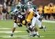 Oct 5, 2013; Iowa City, IA, USA;  Michigan State Spartans cornerback Trae Waynes (15) tackles Iowa Hawkeyes receiver Damon Bullock (5) during the game at Kinnick Stadium. Mandatory Credit: Reese Strickland-USA TODAY Sports